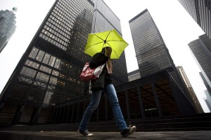 A woman walks in the rain in Toronto on March 4, 2011. THE CANADIAN PRESS/Darren Calabrese