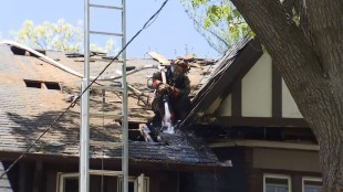 High Park homeowner using blow torch on porch causes roof fire on Pine Crest Road, May 23, 2015. CITYNEWS