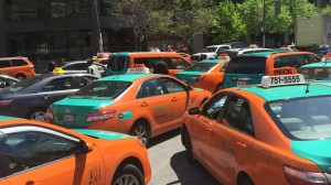 Hundreds of taxi drivers fill Bay Street outside city hall in protest on May 14, 2015. CITYNEWS/Alanna Kelly