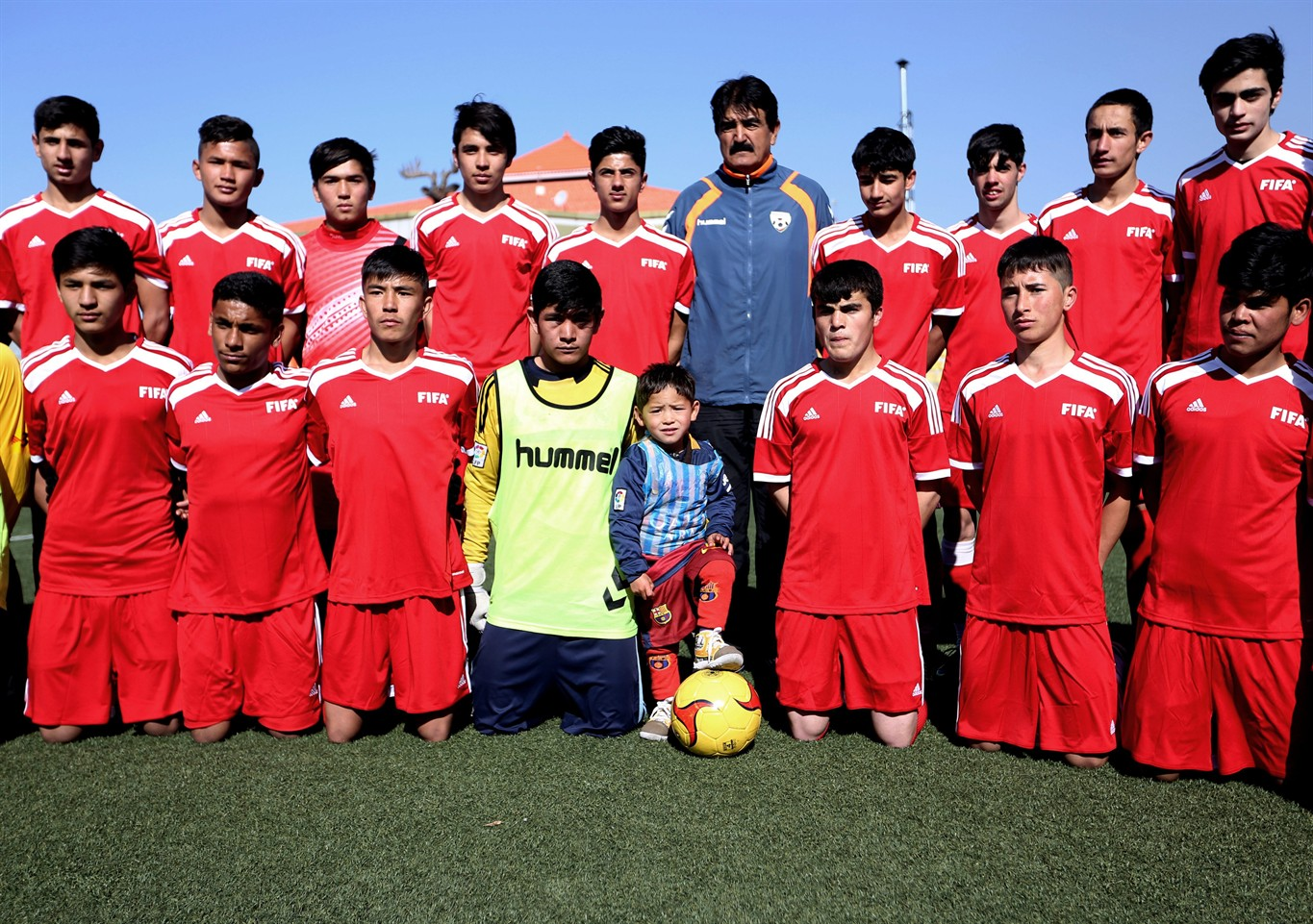 5 year old afghan boy could get to meet lionel messi 680 news martaza ahmadi a five year old afghan lionel messi fan center poses for a photo with a football team at the afghan football federation stadium in kabul m4hsunfo Choice Image
