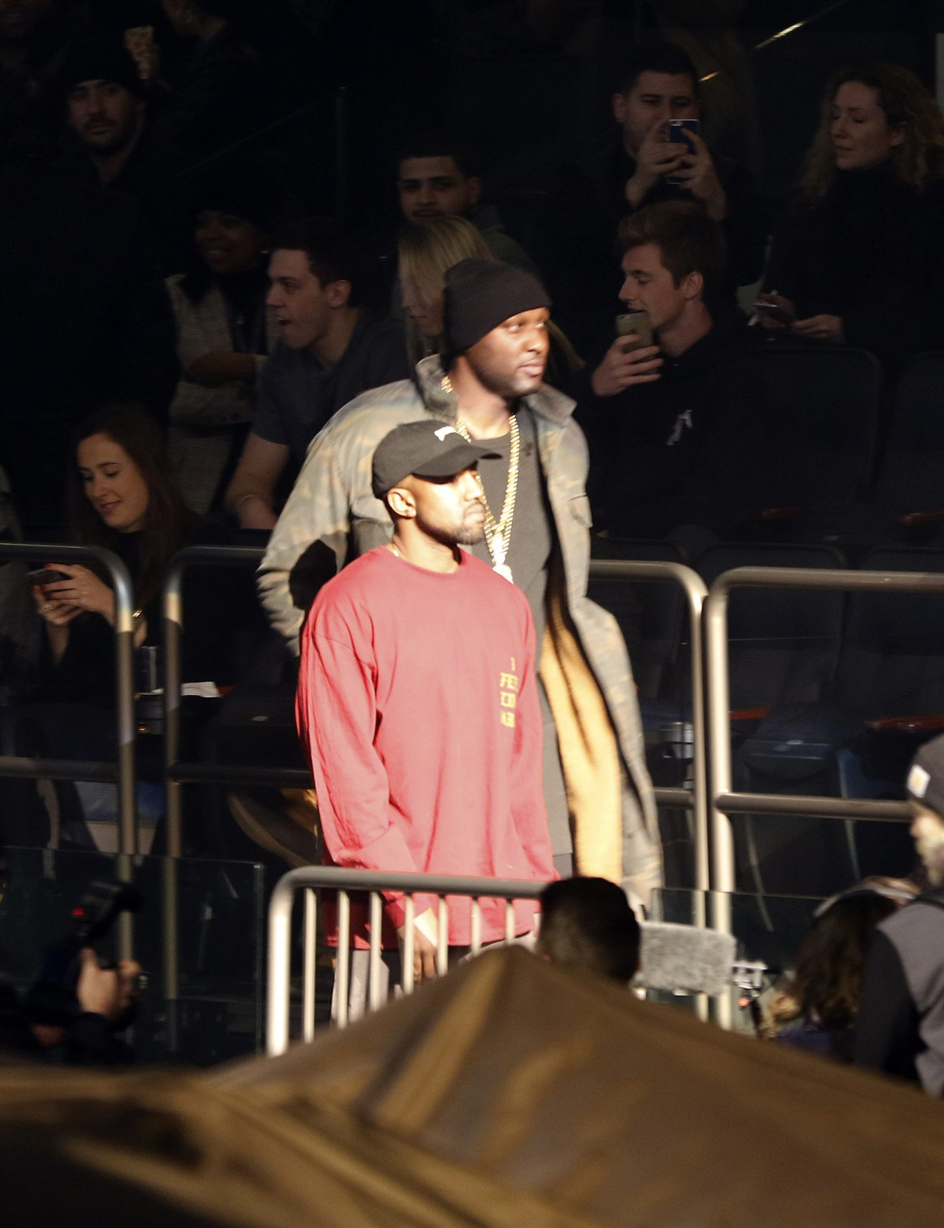 Lamar Odom, Background, And Kanye West Enter Madison Square Garden For The  Unveiling Of The Yeezy Collection And Album Release For Westu0027s Latest  Album, ...