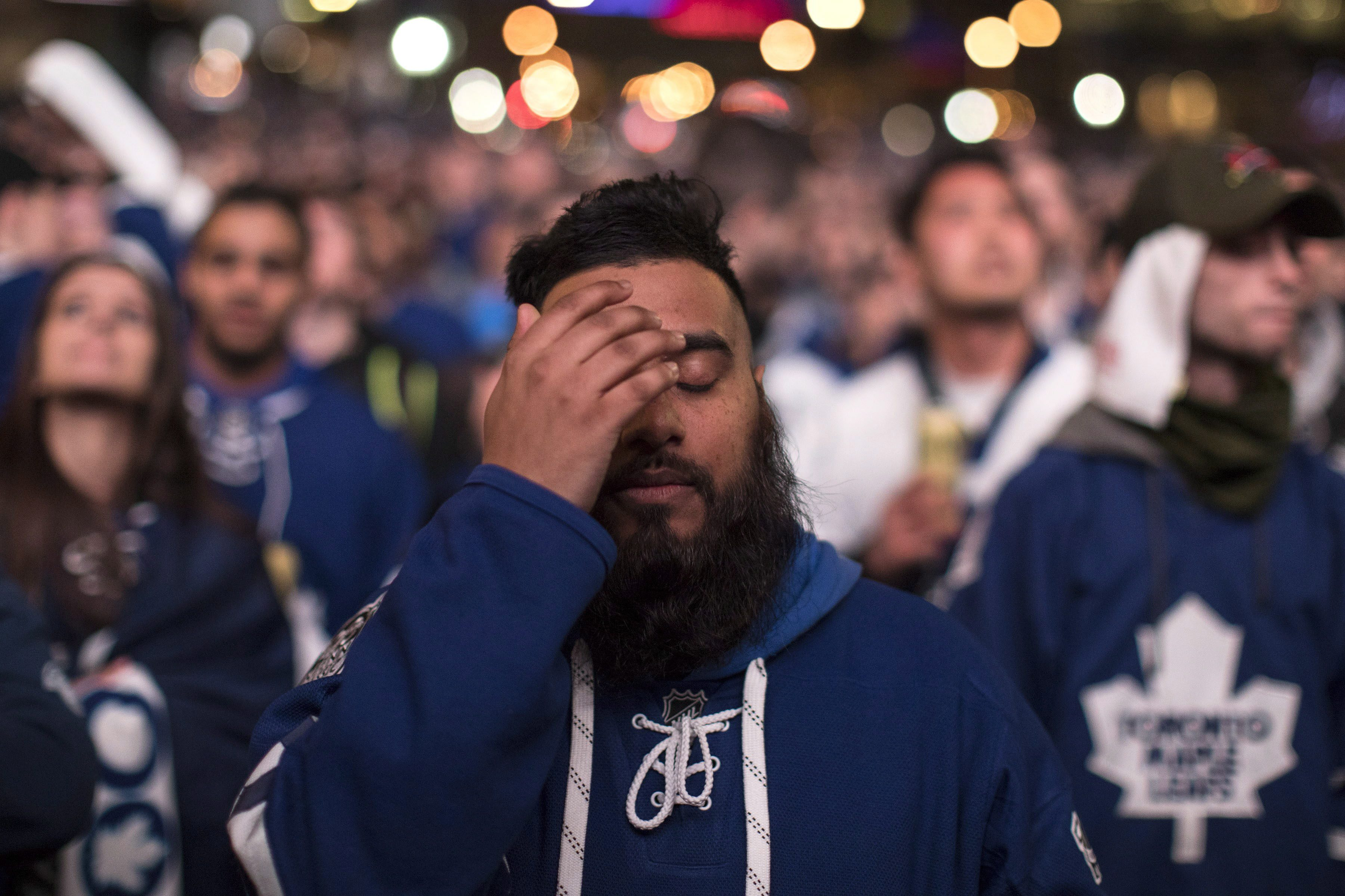 Toronto Maple Leafs Fans Watch Their Team's First Play Off Game Against The  Washington Capitals On A Giant Screen At Maple Leaf Square, In Toronto On