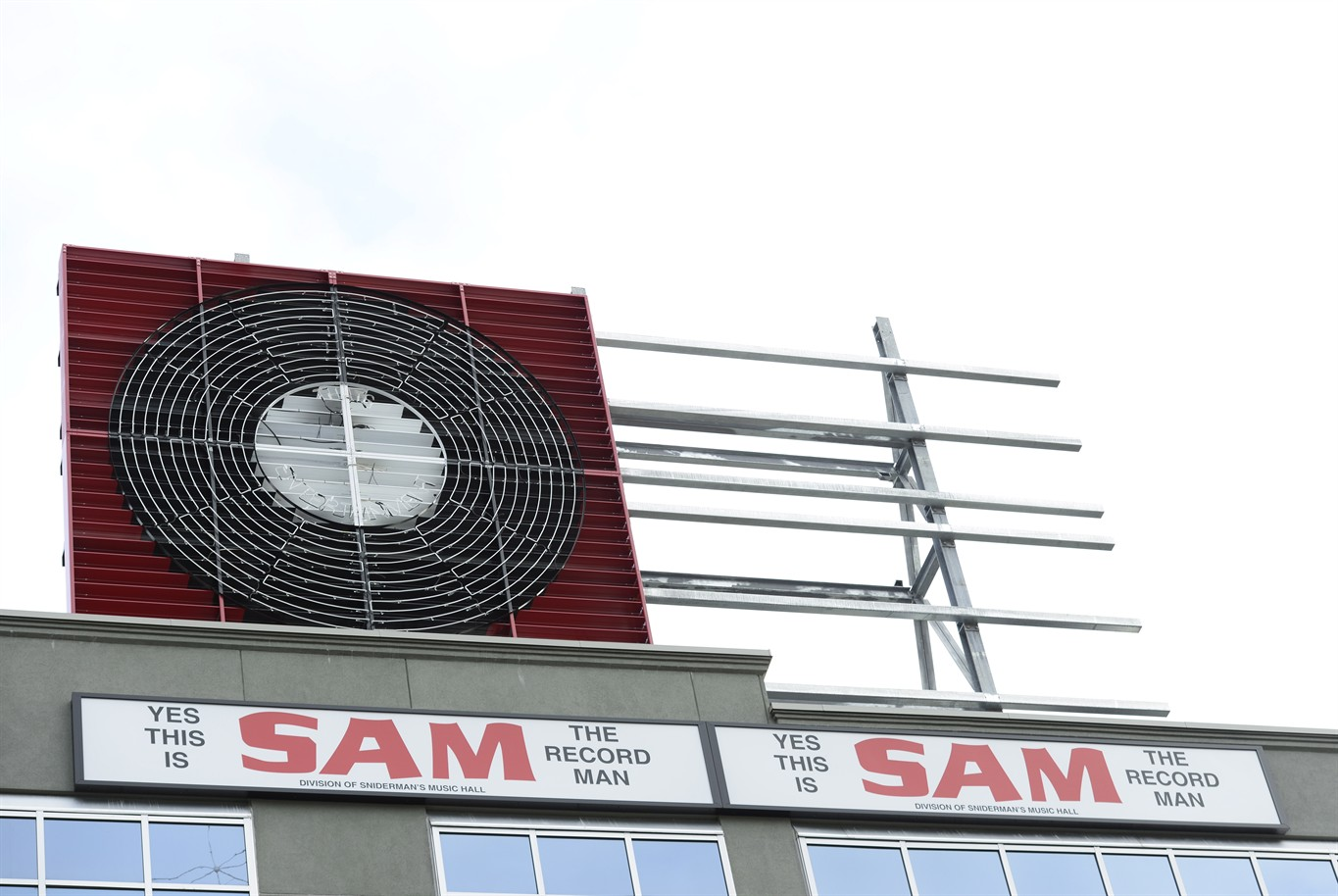 The iconic sign of Sam the Record Man returns