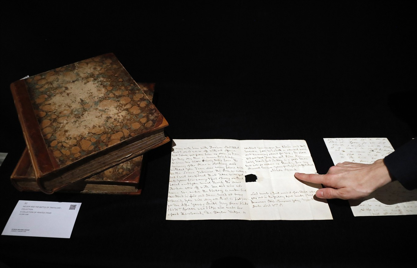 Fragment of flag from nelsons hms victory up for auction 680 news a sothebys employee points to a signature of lord nelson on a letter at sothebys auction house in london thursday jan 11 2018 altavistaventures Gallery