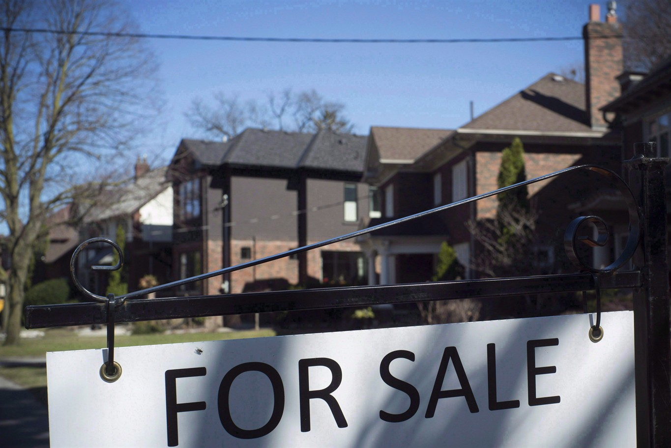 Real estate board predicts flat prices and sales this year