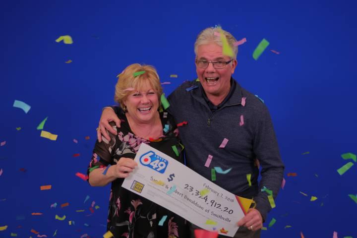 Smithville couple collect $23 million Lotto prize