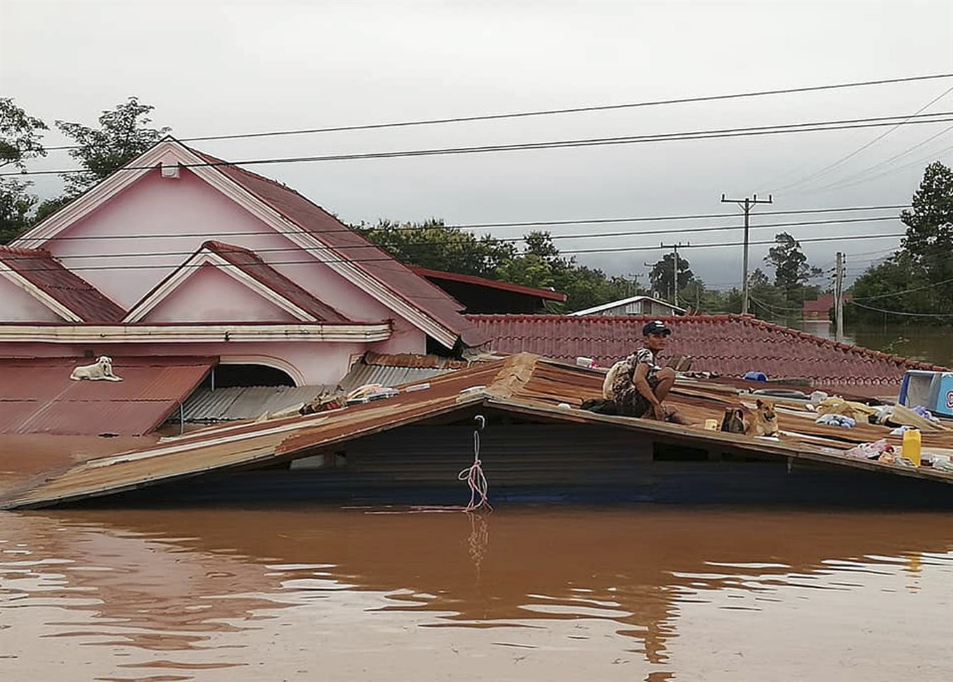 Hundreds missing, 6,000 people homeless after dam breaks near Laos