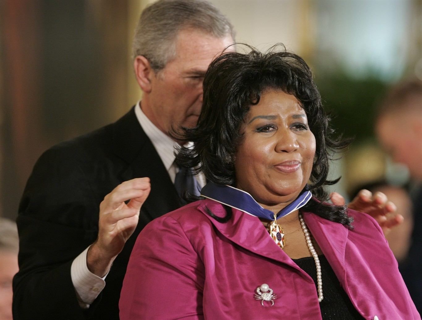 Congregants pay their respects to the Queen of Soul