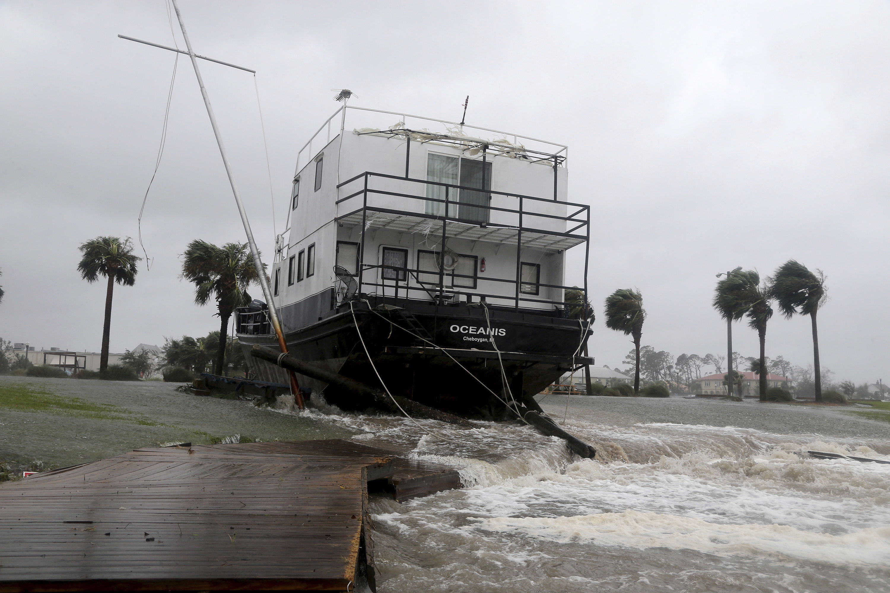 USA  hurricane leaves homes unmoored, power lines damaged