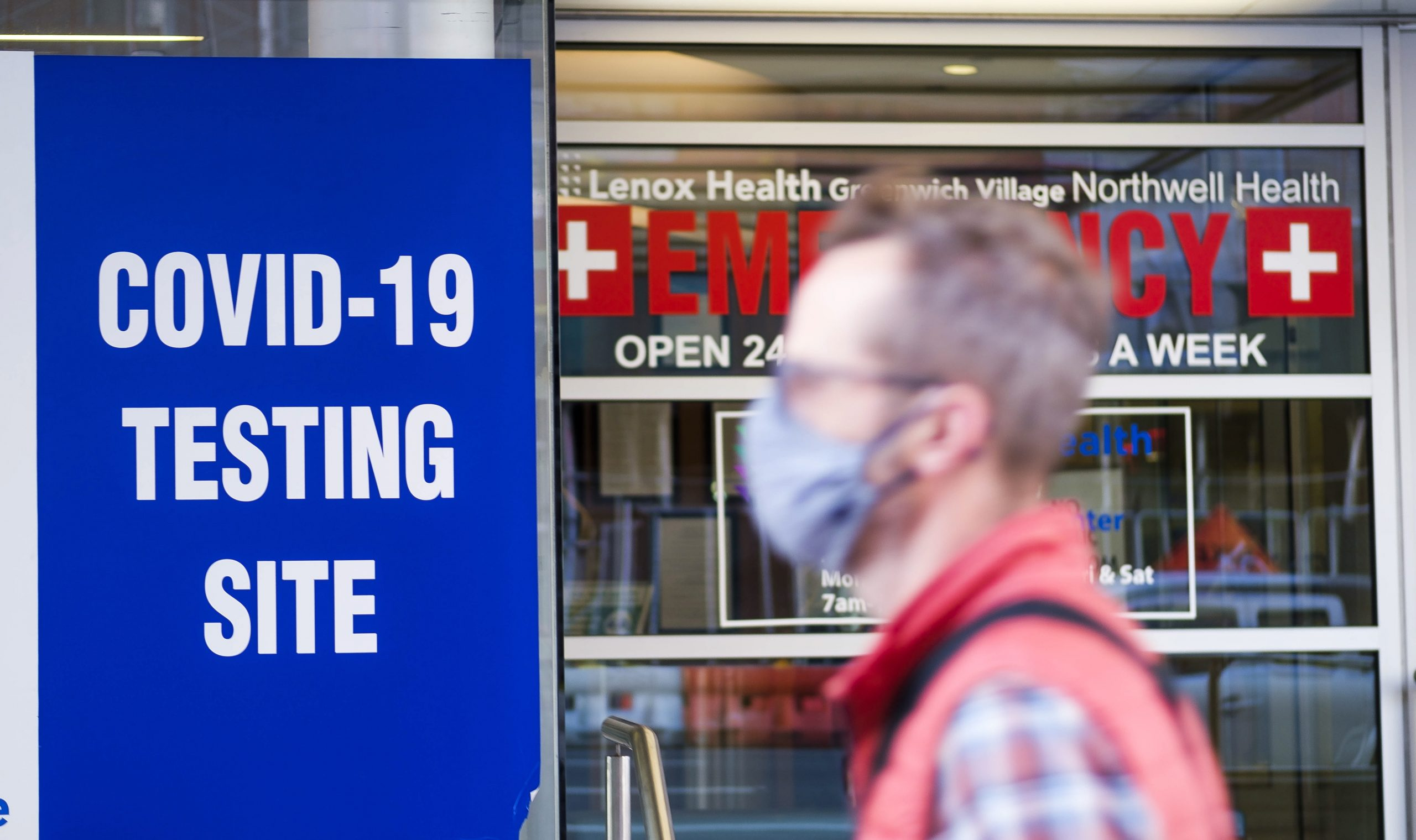 A person walks past a COVID testing site located at an emergency room EPA  JUSTIN LANE