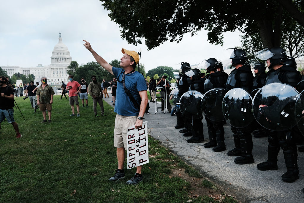 Heavy police presence as protesters trickle in for Capitol rally